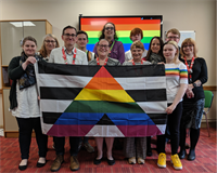 A photo of a group of people holding up the allies flag