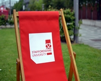 a beach chair with the staffordshire university logo on